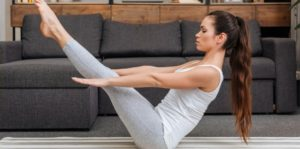 yoga to lose weight in yoga boat pose