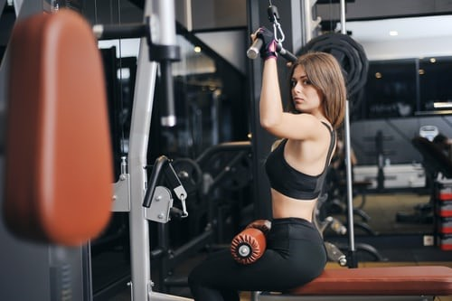 Cable Back Extensions - cable machine with women