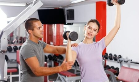 Standing Dumbbell Press - dumbbell workouts
